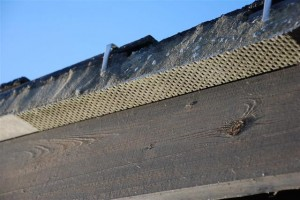 Asbestos cement used as a structural support to the roof eaves