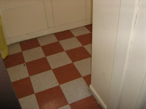 Multi-coloured floor tiles in a 1980's property containing white asbestos